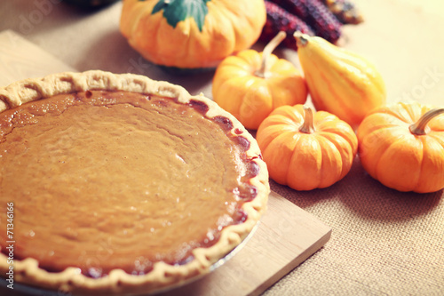 Fotobehang Dessert Pumpkin pie with autumn vegetables