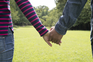 Holding Hands men and women in the park