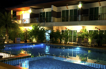 Resort with swimming pool at night