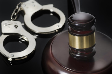 Legal law concept image gavel books handcuffs