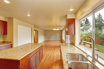 Kitchen furniture with island in empty house
