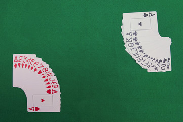 Cards on green casino table