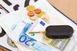 Autokosten - Kennzeichen, Geld und Autoschlüssel