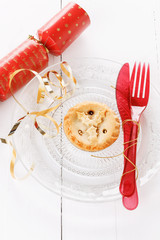 Single Christmas fruit mince pie over white background