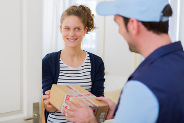 Delivery man handing over a parcel to customer