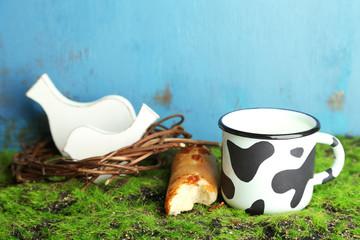 Mug of tasty milk on wooden background