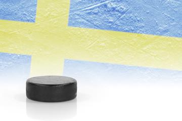 Hockey puck and a Swedish flag