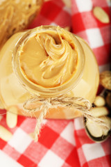 Fresh peanut butter in jar, close up