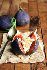 Ripe sweet fig with cottage cheese on wooden background