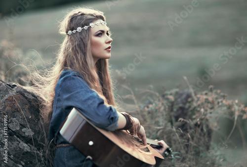 Valokuva Beautiful hippie girl with guitar