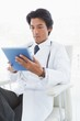 Concentrating doctor using a tablet