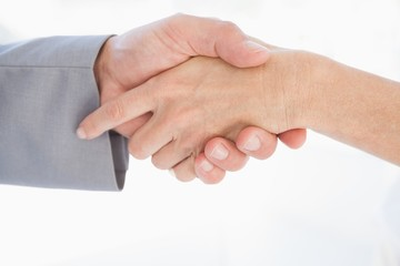 Close up of people shaking hands