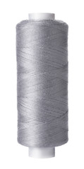 Single reel of gray thread on white background