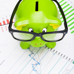 Piggy bank with stock market chart - 1 to 1 ratio