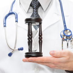 Doctor with hourglass in hand - 1 to 1 ratio