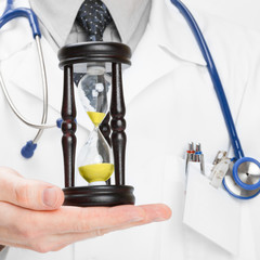 Doctor holdling hourglass - 1 to 1 ratio