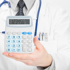 Doctor with calculator - heath care concept - 1 to 1 ratio