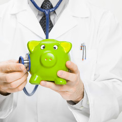 Doctor with piggybank in hand - 1 to 1 ratio