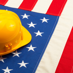 Protective helmet over USA flag - closeup shot - 1 to 1 ratio