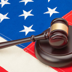 US flag and wooden judge gavel - 1 to 1 ratio