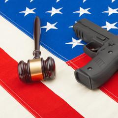 Gun and judge gavel over USA flag - studio shoot - 1 to 1 ratio