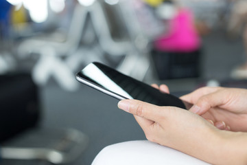 Businesswomen use smart phone during the tourist trip