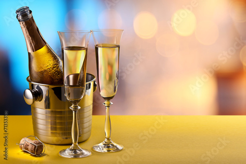 canvas print picture Champagne flutes and chilled bottle.