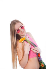 Happy Blond Woman Holding Yellow Flower in hippy Outfit.