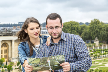 Young Couple Looking in a Map