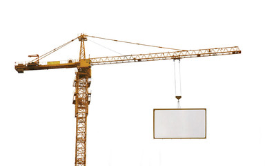 one yellow hoisting crane and advertisement hoardin