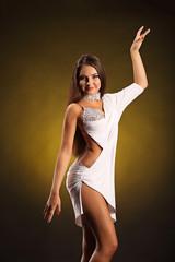 Beautiful professional dancer performs latino dance.