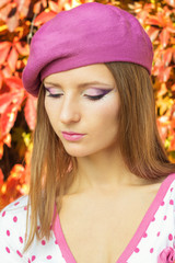 girl in pink hat with beautiful makeup jacket in pink polka dot