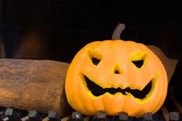 Halloween pumpkin in a fireplace