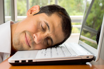 sleeping happy over the laptop