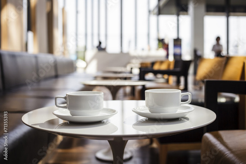 Two Cup of coffees at coffee shop Photo by VTT Studio