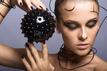 Beautiful cyber girl with black  prickly ball