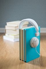 Book with white headphones