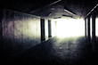 Abstract underground corridor interior with glowing end