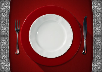Empty Plate on Red Velvet Background