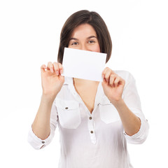Beautiful young woman showing a blank business card