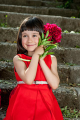 Charming little girl in a red dress