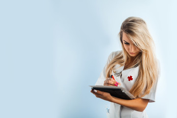 horizontal photo of charming nurse with stethoscope and tablet