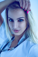 Cold tones portrait of sexual nurse with stethoscope
