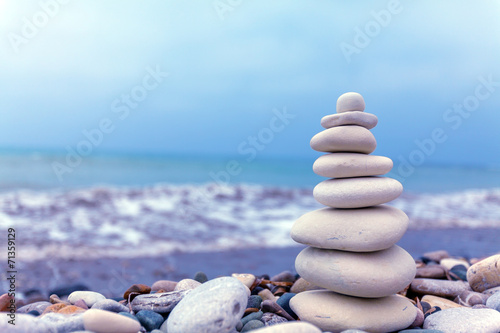 Pyramid of Stones near Sea on Beach - 71359129