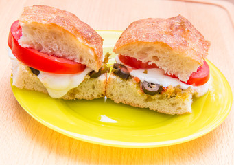 Vegetarian hot sandwiches with pickle muffaletta, tomatoes and m