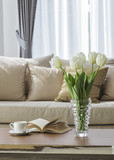 Fototapety Living room sofa with coffee table book and flower