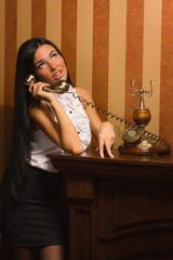 pretty girl talking on retro telephone