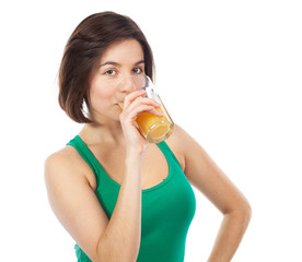 Cute brunette drinking an orange juice