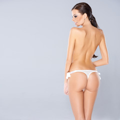 Sexy woman showing off her buttocks