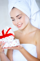 Young woman opening a heart-shaped gift box